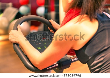 Fit woman working out training indoor in gym center contest - Fitness and healthy lifestyle concept - Soft focus on left hand - Brown filtered look - stock photo