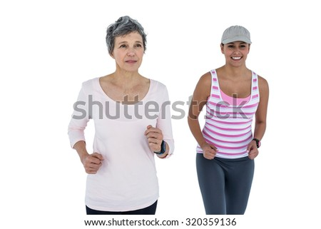 Fit women jogging against white background - stock photo