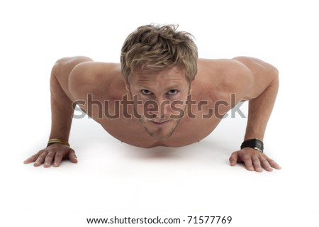Fit young male working out - stock photo