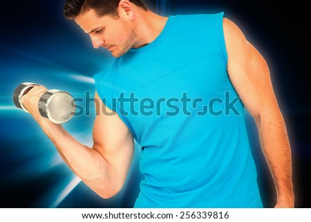 Fit young man exercising with dumbbell against abstract background - stock photo
