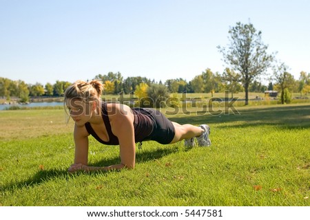 """Fit young woman doing the """"Plank"""" exercise. - stock photo"""