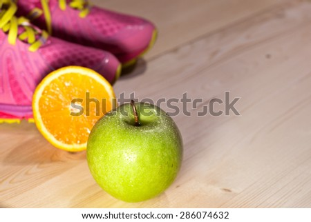 Fitness accessories on the wooden background