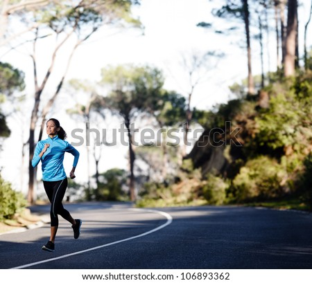 Fitness athlete training alone on a mountain road. Running endurance marathon woman exercising for healthy lifestyle and wellness. panorama with copyspace - stock photo