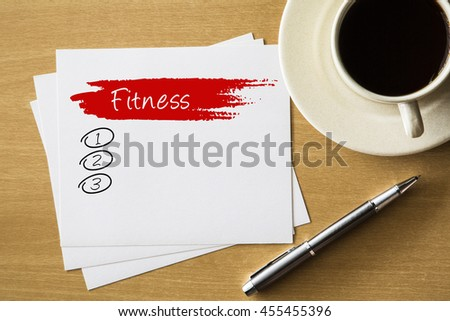 FITNESS blank list, fitness, sport, health concept - handwriting on paper with cup of coffee and pen - stock photo