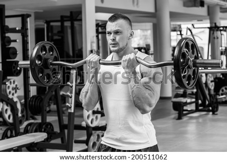 Fitness, bodybuilding. Powerful man during workout - stock photo