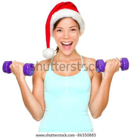 Fitness christmas woman training lifting hand weight wearing santa hat. Female model working out smiling happy and excited isolated on white background. - stock photo