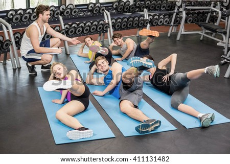 Fitness class working their legs in gym - stock photo