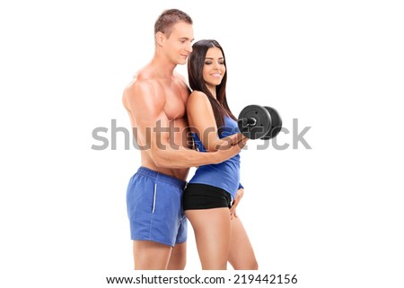 Fitness coach exercising with a female athlete with a barbell isolated on white background - stock photo
