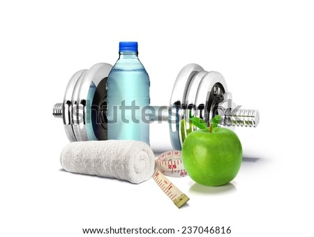 Fitness Concept with Dumbbell and Apple - stock photo