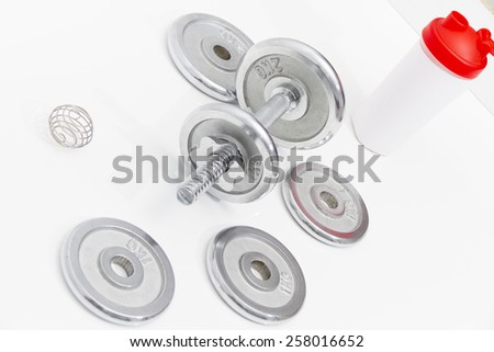 Fitness concept with Grey dumbbells and loose weights