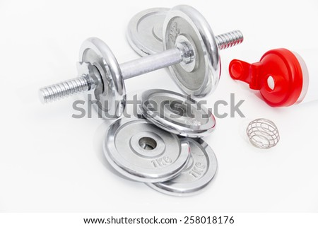 Fitness concept with Grey dumbbells and loose weights - stock photo