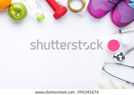 Fitness concept with healthy dieting plan. Fitness equipment and healthy food - stock photo