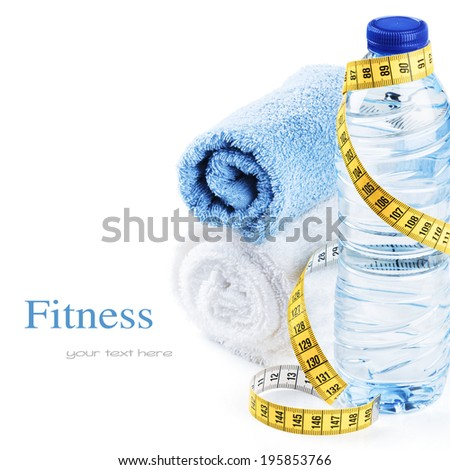 Fitness concept with water bottle and towels  - stock photo