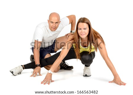 Fitness couple posing isolated in white - stock photo