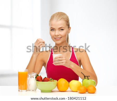 fitness, diet, health and food concept - young woman eating healthy breakfast - stock photo