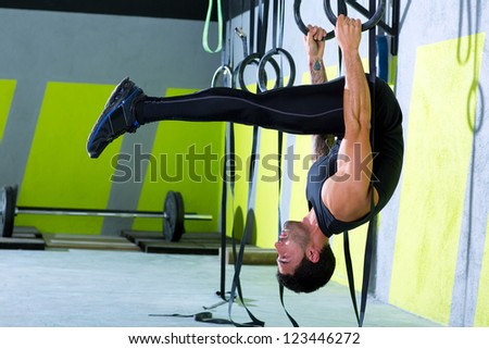 Fitness dip ring man workout at gym dipping exercise - stock photo