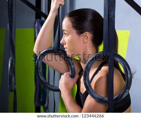 Fitness dip ring woman relaxed after workout at gym dipping exercise - stock photo
