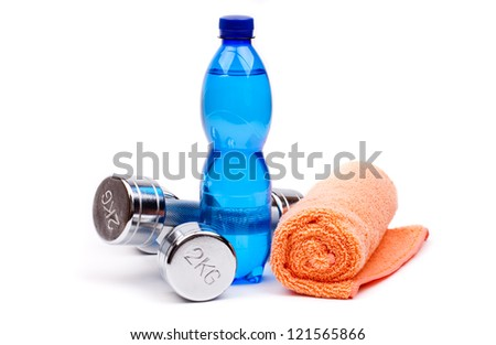 fitness dumbbells  and water - stock photo