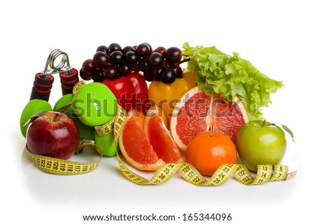fitness equipment and healthy food isolated on white (green and red apples, pepper, grapes, grapefruit, parsley, nectarines, dumbbells and measuring tape)