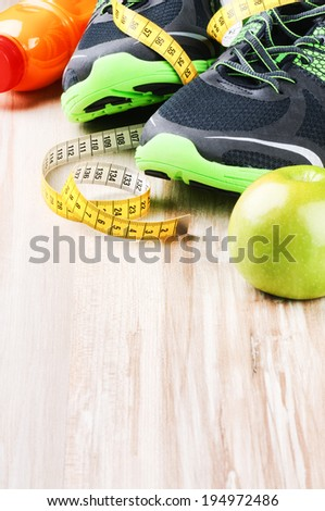 Fitness equipment and healthy nutrition  - stock photo
