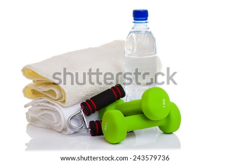 fitness equipment isolated on white (towel, two green dumbbells, simulator for hand and bottle of water) - stock photo