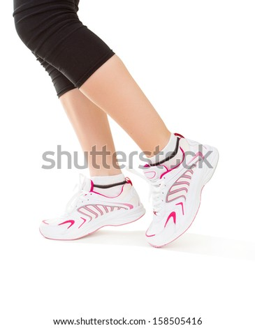 Fitness. Feet of jogging person on white background - stock photo