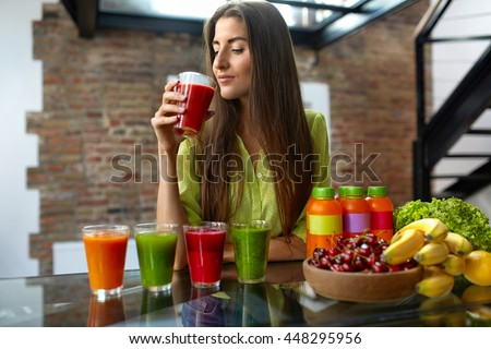 Fitness Food. Healthy Eating Woman On Diet Drinking Fresh Detox Juice, Smoothie For Breakfast. Closeup Of Beautiful Smiling Girl With Fruits And Weight Loss Drinks At Kitchen Table. Nutrition Concept - stock photo