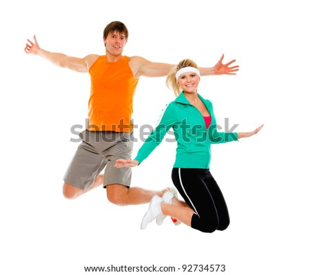 Fitness girl and man in sportswear jumping isolated on white - stock photo