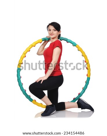 fitness girl kneeling with color hula hoop - stock photo