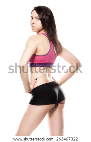 Fitness girl. Sexy athletic woman posing - stock photo