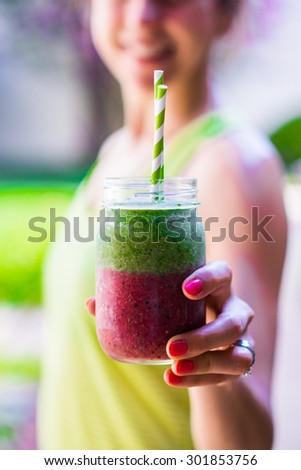 Fitness girl with colorful smoothie - stock photo