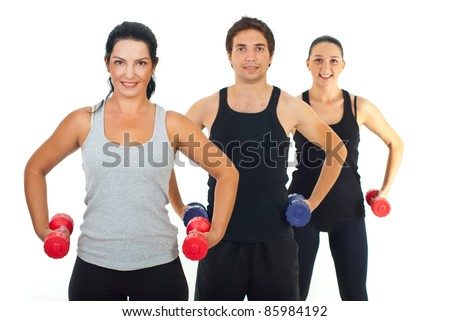 Fitness group of people lifting dumbbell isolated on white background - stock photo