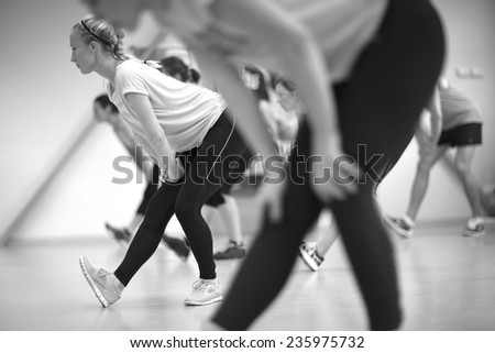 Fitness group session, monochrome - stock photo