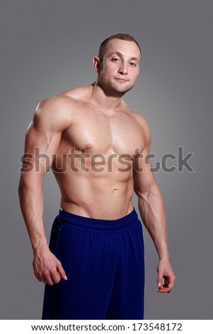 Fitness. Guy and his powerful body