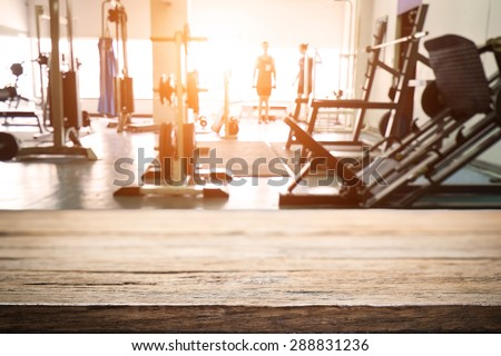 fitness gym and wooden desk space - stock photo