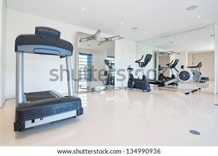 Fitness gym at home. With exercise equipment. - stock photo