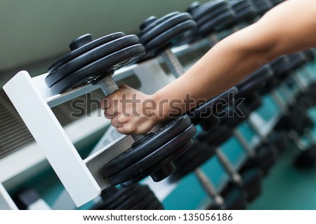 fitness gym weight training equipment indoor - stock photo