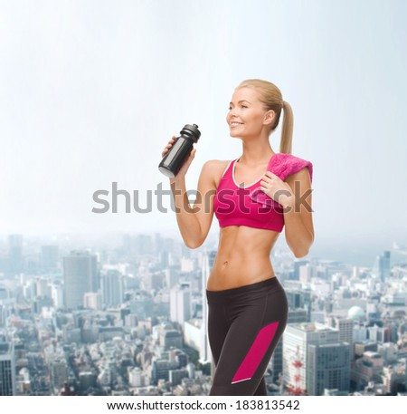 fitness, healthcare and dieting concept - smiling sporty woman drinking water from sportsman bottle - stock photo