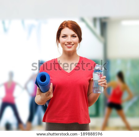 fitness, home and diet concept - smiling teenage girl with bottle of water and yoga mat after exercising at home - stock photo