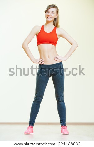 fitness instructor doing pilates or dancing exercises in sport club - stock photo