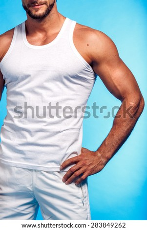 Fitness Instructor Studio Shot over Blue Background - stock photo