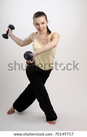 fitness instructor working with dumbbells