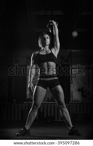 fitness Kettlebells swing exercise woman workout at gym - stock photo