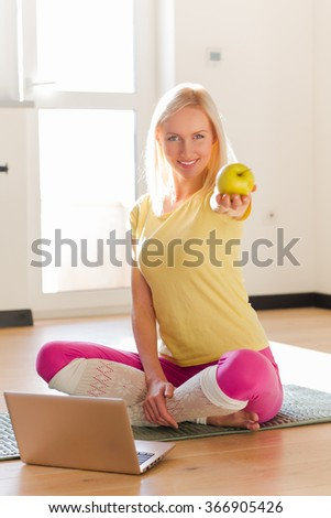 Fitness lady giving apple - stock photo