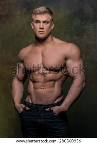 Fitness male model Sergei Mironov - stock photo