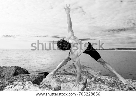 Fitness man having workout on the beach.