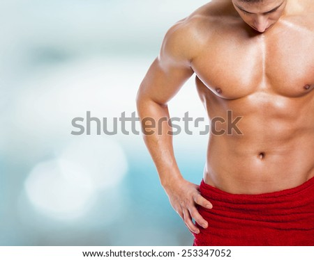 Fitness man in towel at the gym - stock photo