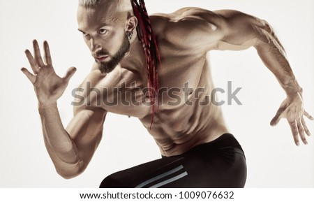 Fitness man running isolated on a gray background