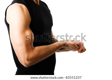 Fitness man showing his muscles
