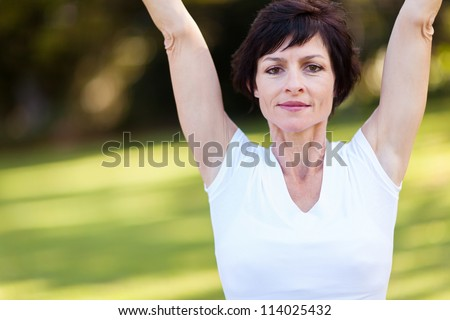 fitness middle aged woman doing stretching exercise - stock photo